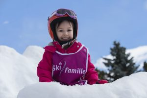 child on ski slopes