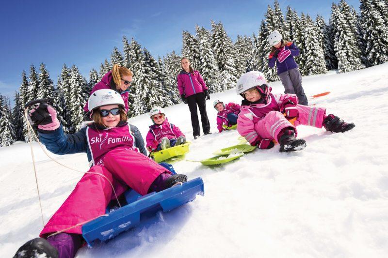 children on ski slopes