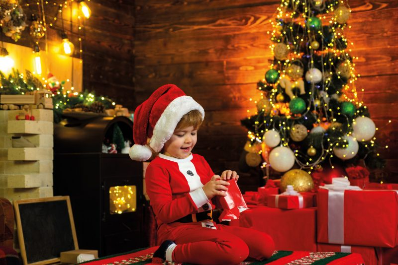 Child in chalet at Christmas